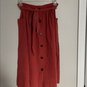 Long skirt with button and tie